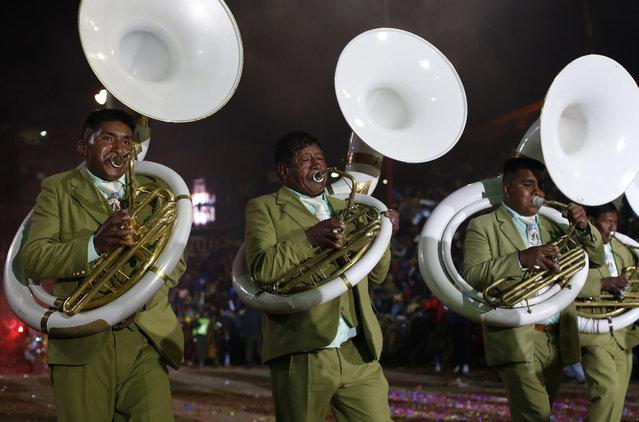 Musicians play during carnival celebrations in Oruro, Bolivia Saturday, February 14, 2015. (Photo by Juan Karita/AP Photo)