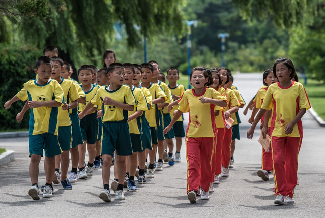 Children sing as they march in formation through Songdowon International School Children's Camp on August 22, 2018 in Wonsan, North Korea. (Photo by Carl Court/Getty Images)