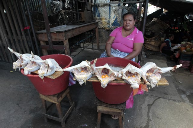 A woman sells chicken at the Oriental Market in Managua, Nicaragua February 17, 2015. (Photo by Oswaldo Rivas/Reuters)
