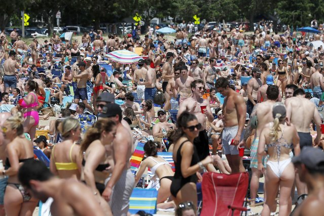 Crowds gather on L Street Beach, Saturday, June 5, 2021, in the South Boston neighborhood of Boston.  New England is giving the rest of the country a possible glimpse into the future if more Americans get vaccinated. The six-state region has among the highest vaccination rates in the U.S. and is seeing sustained drops in COVID-19 cases, hospitalizations and deaths. (Photo by Michael Dwyer/AP Photo)