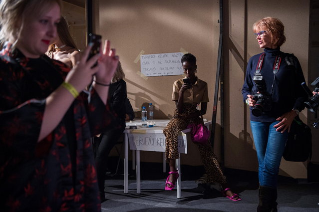 Photo journalists walk backstage during the second bi-annual Budapest Central European Fashion Week in Budapest, Hungary, 27 October 2018. (Photo by Zoltan Balogh/EPA/EFE)