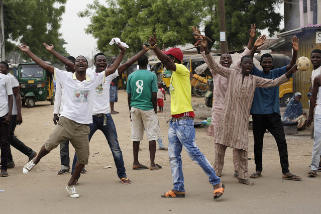 Residents celebrate the anticipated victory of Presidential candidate Muhammadu Buhari  in Kaduna,  Nigeria Tuesday, March 31, 2015. (Photo by Jerome Delay/AP Photo)