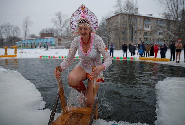 A participant wearing Kokoshnik, the Russian traditional headwear, walks out of the water during winter swimming festival in the town of Podolsk, south of Moscow, Russia January 5, 2017. (Photo by Maxim Shemetov/Reuters)