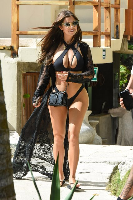 Demi Rose, the 23-year-old star, who has been dubbed the British version of Kim Kardashian, strolled around the party town of Tulum in Mexico on January 10, 2019 in a peep hole bikini. (Photo by KP Pictures)