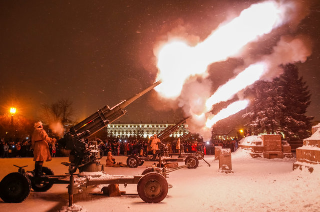 Russian army serviceman fire historical anti-aircraft guns to mark the 75th anniversary since the Leningrad siege was lifted during the World War Two in Saint Petersburg, Russia on January 27, 2019. (Photo by Anton Vaganov/Reuters)