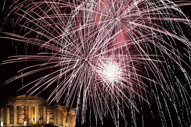 Fireworks explode over the ancient Parthenon temple at the Acropolis Hill  during the New Year's Eve celebrations in Athens, on Wednesday, January 1, 2014. (Photo by Petros Giannakouris/AP Photo)