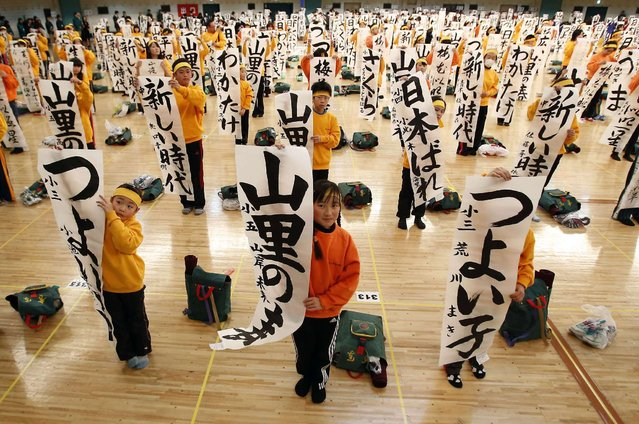 Participants show off their writing at a New Year calligraphy contest in Tokyo January 5, 2014. About 3,000 calligraphers, who qualified in regional competitions throughout Japan, took part in the contest to celebrate the New Year. (Photo by Yuya Shino/Reuters)