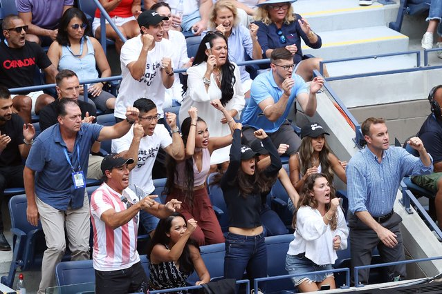 Fans and coach Duglas Corder (lower L) of Leylah Annie Fernandez of Canada cheer as she plays against Emma Raducanu of Great Britain during their Women's Singles final match on Day Thirteen of the 2021 US Open at the USTA Billie Jean King National Tennis Center on September 11, 2021 in the Flushing neighborhood of the Queens borough of New York City. (Photo by Matthew Stockman/Getty Images)