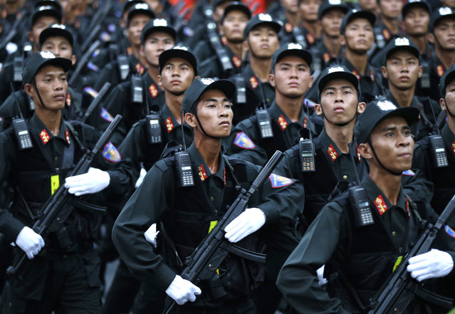 """Military personnel take part in a parade celebrating the 40th anniversary of the end of the Vietnam War which is also remembered as the """"Fall of Saigon"""", in Ho Chi Minh City, Vietnam, Thursday, April 30, 2015. (Photo by Dita Alangkara/AP Photo)"""