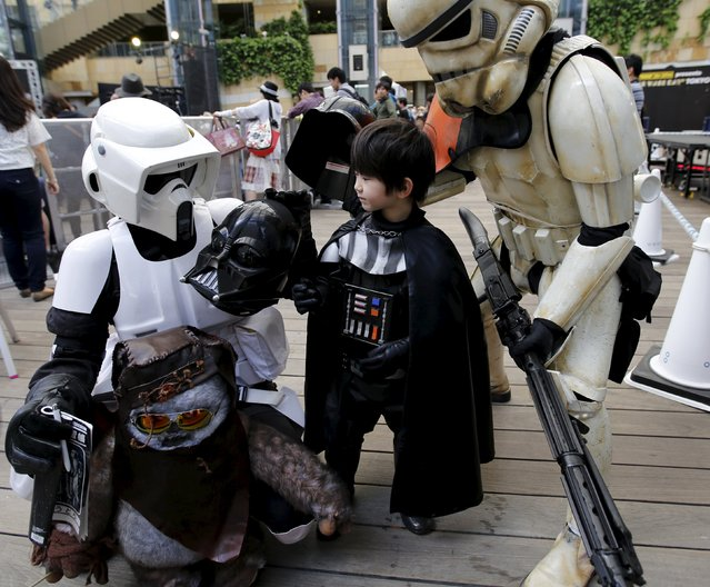 Cosplayers dressed up as Star Wars characters Scout Trooper (L), Storm Trooper (R) and Darth Vader take part in a Star Wars Day fan event in Tokyo May 4, 2015. (Photo by Toru Hanai/Reuters)