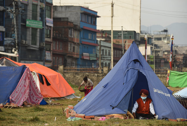 People  displaced by the earthquake go about their day as they live in a tent encampment on Tuesday May 05, 2015 in Kathmandu, Nepal. A deadly earthquake has killed thousands in Nepal. (Photo by Matt McClain/The Washington Post)