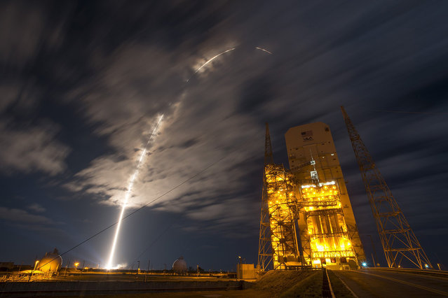 This photo released by NASA on March 23, 2016 shows a United Launch Alliance Atlas V rocket carrying Orbital ATK's Cygnus spacecraft on a resupply mission to the International Space Station lifting off from Space Launch Complex 41 on Cape Canaveral Air Force Station in Florida at 11:05 p.m. EDT on March 22, 2016. The Cygnus is scheduled to arrive at the orbiting laboratory Saturday, March 26. Nearly 7,500 pounds of supplies, science payloads and experiments are headed to the station aboard Cygnus, including scientific investigations of fire in microgravity and grippers inspired by geckos, along with equipment to support some 250 other studies. (Photo by AFP Photo/NASA)