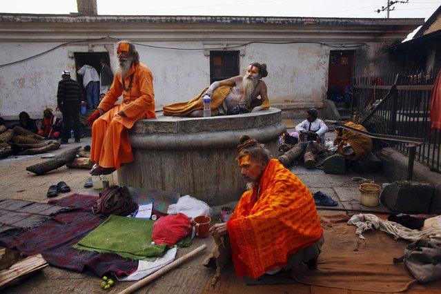 Hindu holy men rest in the courtyard of the Pashupatinath Temple in Katmandu, Nepal, Wednesday, February 26, 2014. (Photo by Niranjan Shrestha/AP Photo)