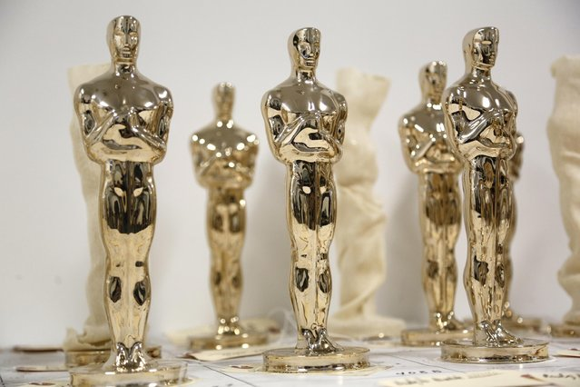 Oscar statuettes, some wrapped in cloth, wait to be inspected before being finished at the Polich Tallix Fine Art Foundry in Rock Tavern, N.Y., Thursday, January 12, 2017. Every Oscar fist-pumped or tearfully cradled by Academy Award winners is first cast, buffed and fussed over by people far from Hollywood who have spent the last several months making 60 identical gold Oscars for the Feb. 26th awards. (Photo by Seth Wenig/AP Photo)