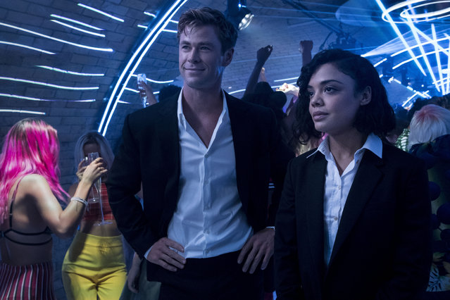 "This image released by Sony Pictures shows Chris Hemsworth, left, and Tessa Thompson in a scene from Columbia Pictures' ""Men in Black: International"". (Photo by Giles Keyte/Sony/Columbia Pictures via AP Photo)"
