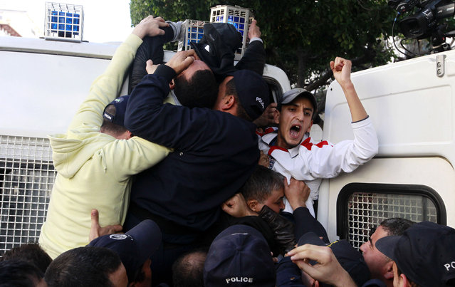 Police detain protesters during a demonstration against Algerian President Abdulaziz Bouteflika's decision to run for a fourth term, in Algiers March 6, 2014. Bouteflika on Monday formally registered his candidacy for April's election, one of the few times the aging independence veteran has spoken in public since suffering a stroke last year. (Photo by Louafi Larbi/Reuters)