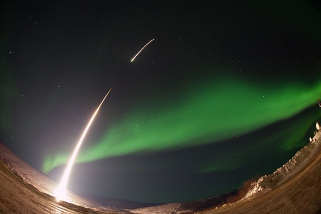 A NASA-funded sounding rocket launches into an aurora over Venetie, Alaska. (Photo by Reuters/Stringer)