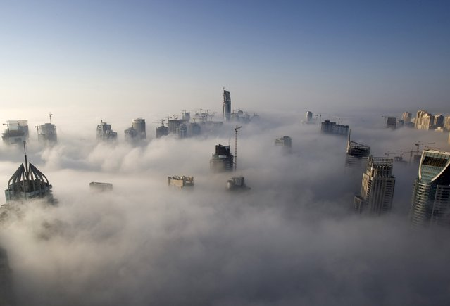 Heavy fog rolls by early in the morning near the Dubai Marina, United Arab Emirates, in this November 21, 2007 file photo. (Photo by Steve Crisp/Reuters)