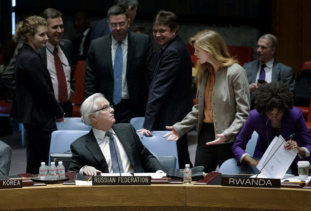 Russia's U.N. Ambassador Vitaly Churkin, and United States' U.N. Ambassador Samantha Power interact before the U.N. Security Council meeting on the Ukraine crisis, at United Nations headquarters in New York, on March 15, 2014. Russia vetoed a U.N. resolution declaring Sunday's referendum on the future of Ukraine's Crimean Peninsula illegal, but its close ally China abstained in a show of Moscow's isolation. (Photo by John Minchillo/Associated Press)