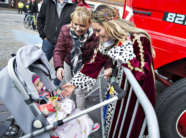 Women interact with a baby in a stroller during the Grand Parade of Aalborg Carnival in Aalborg, Denmark May 23, 2015. (Photo by Henning Bagger/Reuters/Scanpix Denmark)
