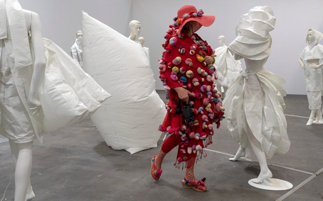 An arty dressed visitor looks at the artwork Life Dress (2018) by Barcelona-born and Amsterdam based artist Alicia Framis at the show Art Unlimited in the context of the international art show Art Basel, in Basel, Switzerland, 11 June 2019. Unlimited is Art Basel's exhibition platform for projects that transcend the limitations of a classical art-show stand, including out-sized sculpture and paintings, video projections, large-scale installations, and live performances. (Photo by Georgios Kefalas/EPA/EFE/Rex Features/Shutterstock)