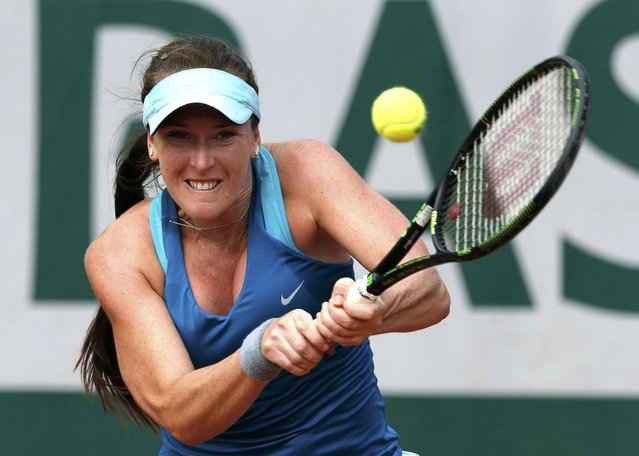 Madison Brengle of the U.S. plays a shot to Samantha Stosur of Australia during their women's singles match at the French Open tennis tournament at the Roland Garros stadium in Paris, France, May 25, 2015. (Photo by Pascal Rossignol/Reuters)