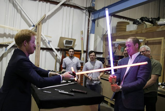 Britain's Prince William (R) tries a light sabre against his brother Prince Harry during a visit to the Star Wars film set at Pinewood Studios near Iver Heath, west of London, Britain, April 19, 2016. (Photo by Adrian Dennis/Reuters)