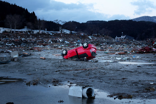 Destroyed vehicles lie near the rubble after the earthquake and tsunami devastated the area on March 16, 2011 in Minamisanriku, Japan. The 9.0 magnitude strong earthquake struck offshore on March 11 at 2:46pm local time, triggering a tsunami wave of up to ten metres which engulfed large parts of north-eastern Japan. The death toll continues to rise and could well reach 10,000 in a tragedy not seen since World War II in Japan. (Photo by Chris McGrath/Getty Images)