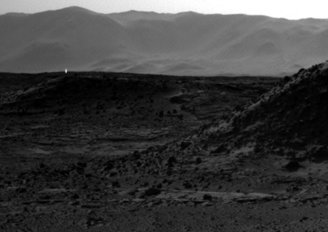 A handout photo provided by NASA on 09 April 2014 shows an image from the Navigation Camera (Navcam) on NASA's Curiosity Mars rover including a bright spot near the upper left corner. (Photo by EPA/NASA/JPL-Caltech)