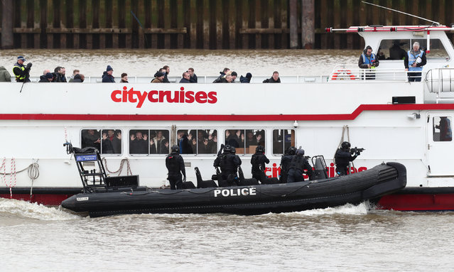 Police officers take part in a multi-agency exercise, to test the emergency services' response to a marauding terrorist attack in London, on the river Thames in east London, Sunday March 19, 2017. (Gareth Fuller/PA Wire via AP Photo)