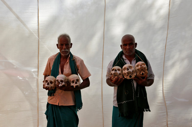 Farmers from the southern state of Tamil Nadu display skulls, who they claim are the remains of Tamil farmers who have committed suicide, during a protest demanding a drought-relief package from the federal government, in New Delhi, India March 22, 2017. (Photo by Cathal McNaughton/Reuters)