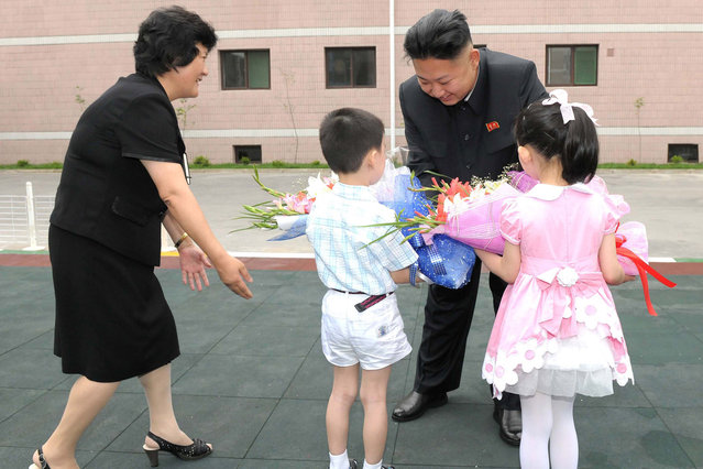 North Korean leader Kim Jong-Un (2nd R) visits Kyongsang Kindergarten in Pyongyang in this undated picture released by the North's KCNA July 15, 2012. (Photo by Reuters/KCNA)