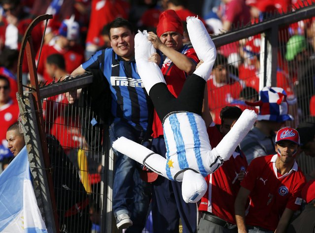 Chile fans hold a mannequin dressed in Argentina colors prior to their match in the Copa America 2015 final soccer at the National Stadium in Santiago, Chile, July 4, 2015. (Photo by Marcos Brindicci/Reuters)