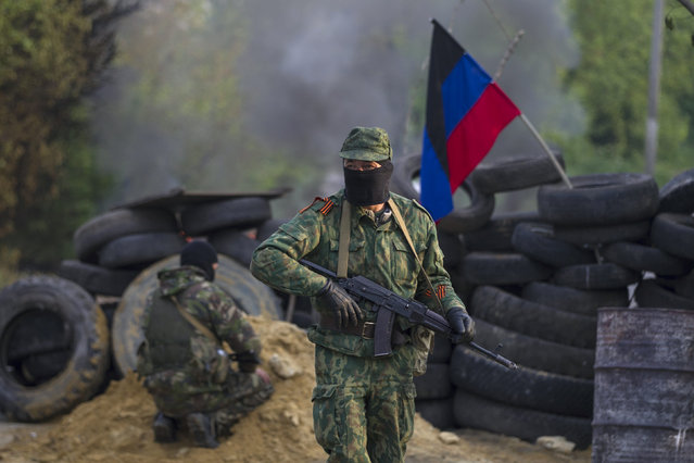 Pro-Russian separatists guard a checkpoint near the town of Slaviansk in eastern Ukraine May 2, 2014. (Photo by Baz Ratner/Reuters)