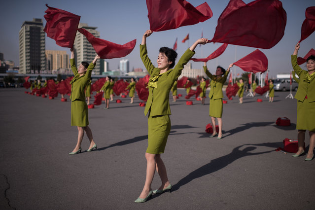 Members of a propaganda troupe perform in a public square in Pyongyang on April 12, 2017. (Photo by Ed Jones/AFP Photo)