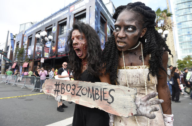 Two zombies wander through the Gaslamp District on first day of the 2015 Comic-Con International held at the San Diego Convention Center Thursday, July 9, 2015 in San Diego. (Photo by Denis Poroy/Invision/AP Photo)