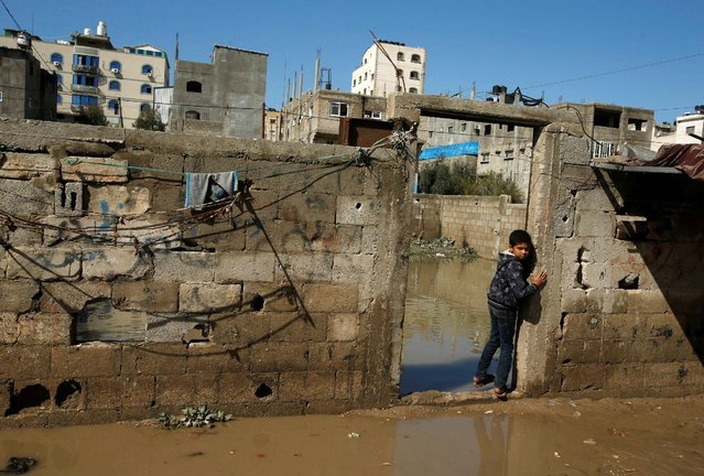 A Palestinian boy stands next to floodwaters following a rainstorm, in the northern Gaza Strip February 17, 2017. (Photo by Mohammed Salem/Reuters)