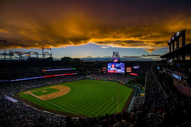 The sun sets over the stadium as the Colorado Rockies take on the Los Angeles Dodgers at Coors Field on April 7, 2019 in Denver, Colorado. (Photo by Justin Edmonds/Getty Images)