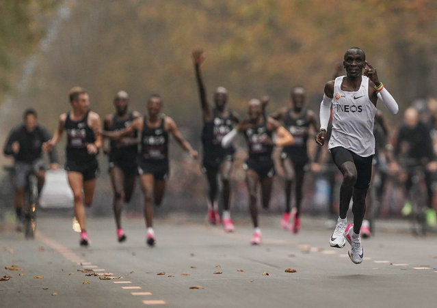 Eliud Kipchoge runs on his way to break the historic two hour barrier for a marathon in Vienna, Saturday, October 12, 2019. Eliud Kipchoge has become the first athlete to run a marathon in less than two hours, although it will not count as a world record. The Olympic champion and world record holder from Kenya clocked 1 hour, 59 minutes and 40 seconds Saturday at the INEOS 1:59 Challenge, an event set up for the attempt. (Photo by Jed Leicester/The INEOS 1:59 Challenge via AP Photo)