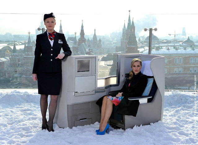 International film actress Gillian Anderson pictured on the rooftop of the Ritz-Carlton Hotel overlooking Red Square in a British Airways Business Class seat to launch the British Airways long haul service on the London – Moscow route