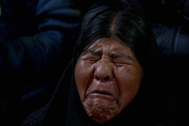 Virginia Ticona mourns during the funeral of her son, Antonio Quispe in El Alto, outskirts of La Paz, Bolivia, Wednesday, November 20, 2019. Quispe was killed on Tuesday when security forces escorting gasoline tankers from a fuel plant clashed with supporters of former President Evo Morales that had been blockading it for five days. (Photo by Natacha Pisarenko/AP Photo)