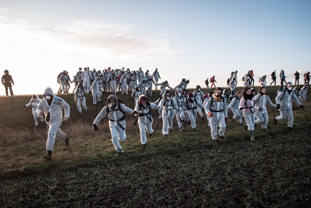 "Climate activists block the opencast mine Vereinigtes Schleenhain south of Leipzig in Germany on November 30, 2019. According to the alliance ""Ende Gelände"", up to 1200 people had gathered in the district. At the Schleenhain and Jänschwalde opencast mines, various climate protests are planned for the weekend. (Photo by Tim Wagner/Imago)"