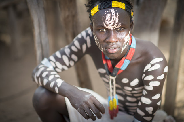 """""""Karo man with body paint"""". Fierce Karo warrior with body paint. Photo location: Omo Valley, Ethiopia. (Photo and caption by Sean Caffrey/National Geographic Photo Contest)"""