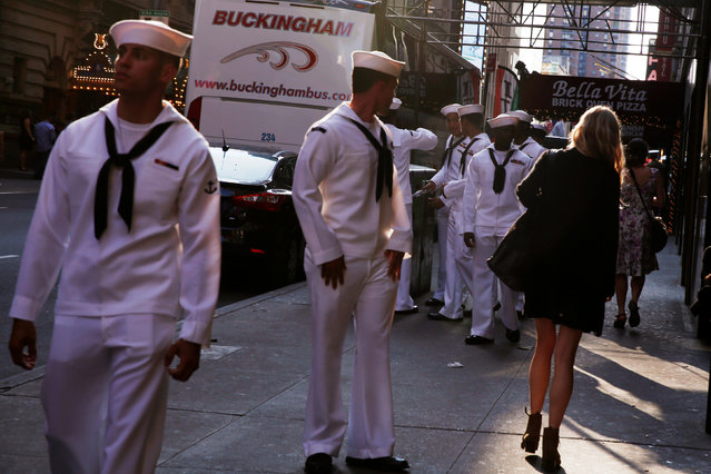 U.S. Navy sailors watch a woman walk past as they walk through Times Square during Fleet Week in New York, U.S., May 25, 2016. (Photo by Lucas Jackson/Reuters)