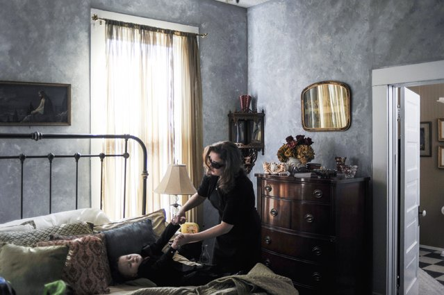 Seth's wife Rosie wakes up her son Aiden before her husband's viewing. He had been killed in Afghanistan the previous week. (Photo and caption by Van Agtmael/Harrison Jacobs/Magnum Photos)