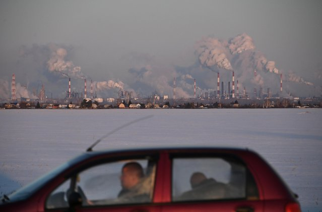 A car drives past the Gazprom Neft's oil refinery in Omsk, Russia on February 10, 2020. (Photo by Alexey Malgavko/Reuters)