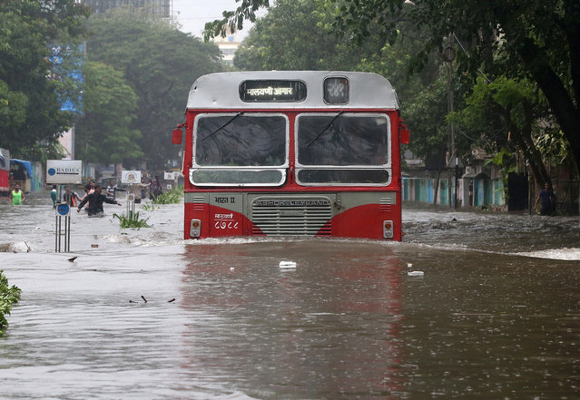 A passenger bus moves through a water-logged road during rains in Mumbai, August 29, 2017. (Photo by Shailesh Andrade/Reuters)