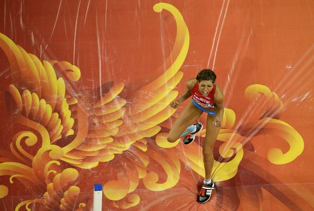 Croatia's Blanka Vlasic celebrates after clearing the bar in the women's high jump final at the World Athletic Championships at the Bird's Nest stadium in Beijing, Saturday, August 29, 2015. (Photo by /Wong Maye-E/AP Phot)