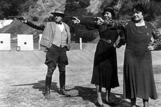 Two women members of the police department in Pasadena, California, showing remarkable aptitude with the revolver under the instruction of Sergeant Bailey, circa 1935.  (Photo by General Photographic Agency)
