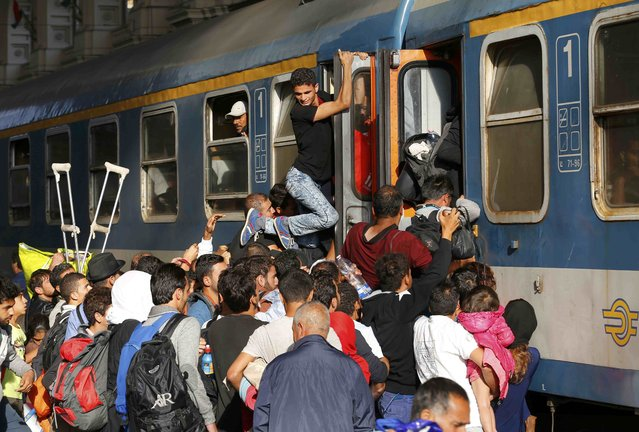 Migrants stoming trains in the Keleti train station in Budapest, Hungary, September 3, 2015 as Hungarian police withdrew from the gates after two days of blocking their entry. (Photo by Laszlo Balogh/Reuters)